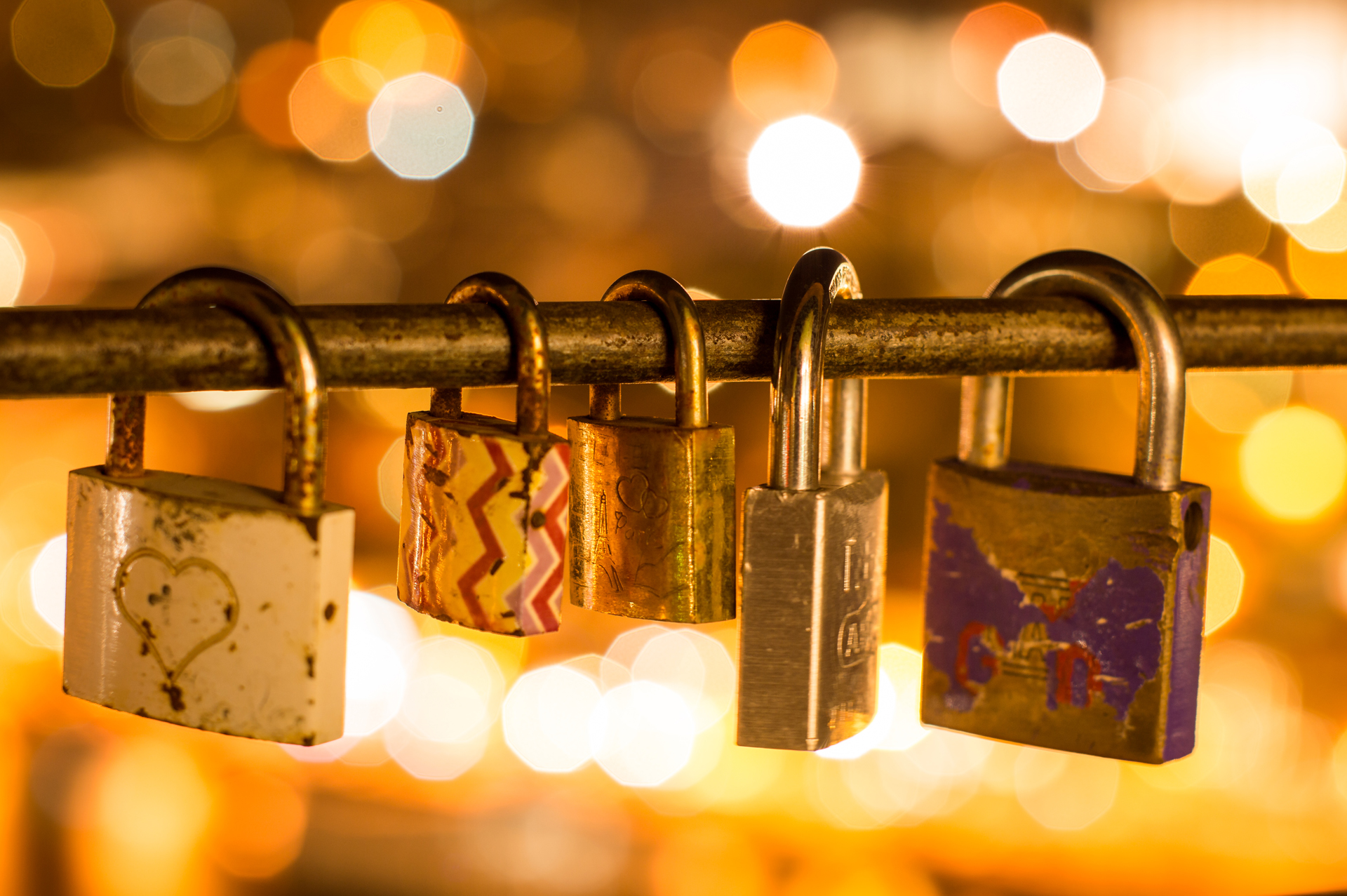Some of the dozens of love locks on Serra do Pilar, Vila Nova de Gaia, with the Porto's city lights on the background
